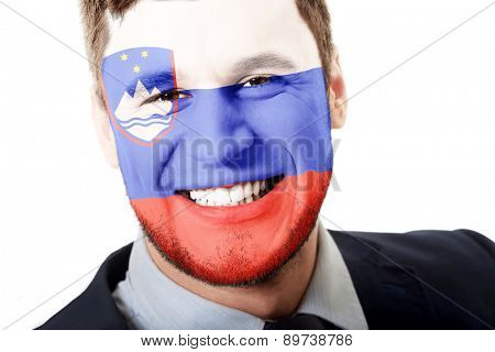 Happy man with Slovenia flag painted on face.