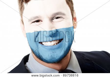Happy man with San Marino flag painted on face.