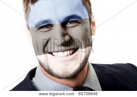 Happy man with Estonia flag painted on face.