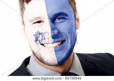 Happy man with Israel flag painted on face.