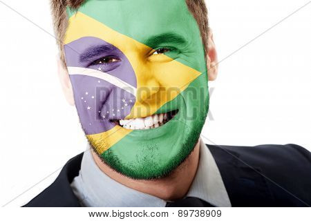 Happy man with Brasil flag painted on face.