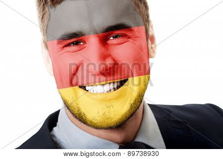 Happy man with Germany flag painted on face.