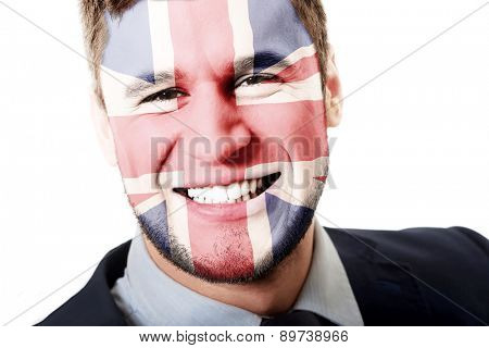 Happy man with Great Britain flag painted on face.