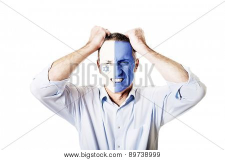 Mature man with Israel flag painted on face.
