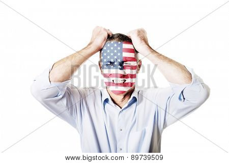 Mature man with usa flag painted on face.