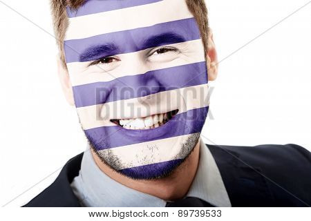 Happy man with Greece flag painted on face.