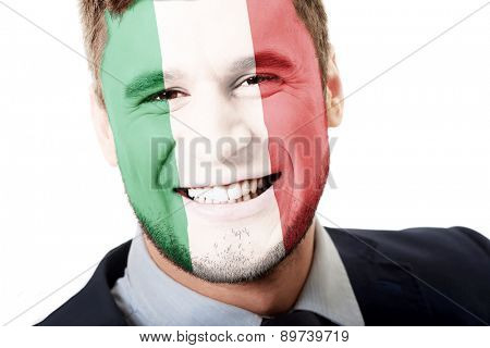 Happy man with Italy flag painted on face.