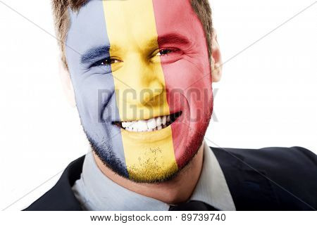 Happy man with Romania flag painted on face.