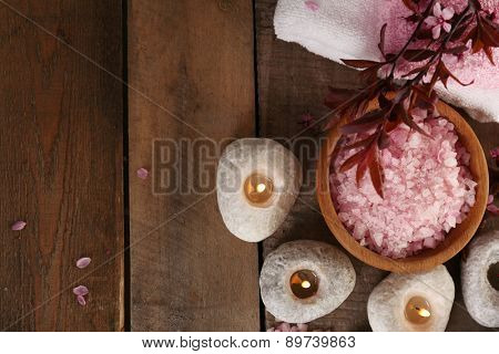 Beautiful spa composition with spring flowers on wooden background