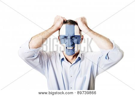 Mature man with Finland flag painted on face.