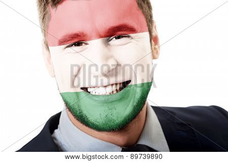 Happy man with Hungary flag painted on face.
