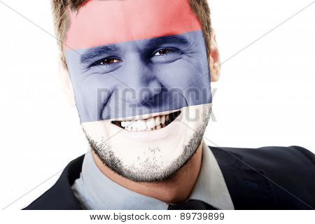 Happy man with Serbia flag painted on face.