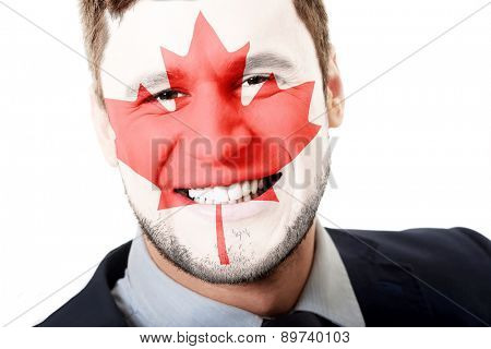Happy man with Canada flag painted on face.