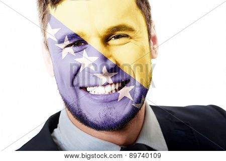Happy man with Bosnia and Herzegovina flag painted on face.