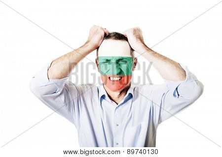 Mature man with Bulgaria flag painted on face.
