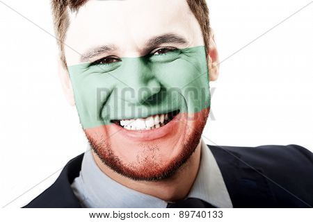 Happy man with Bulgaria flag painted on face.