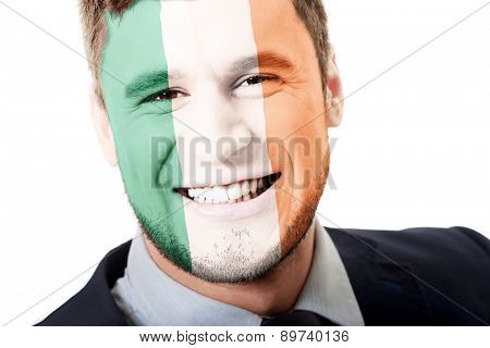 Happy man with Ireland flag painted on face.