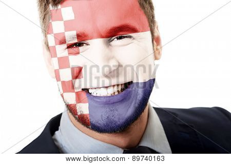Happy man with Croatia flag painted on face.