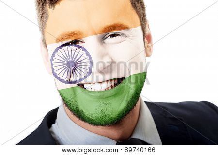 Happy man with India flag painted on face.