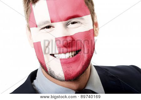 Happy man with Denmark flag painted on face.