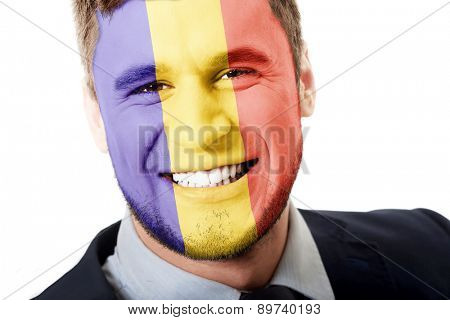 Happy man with Andora flag painted on face.