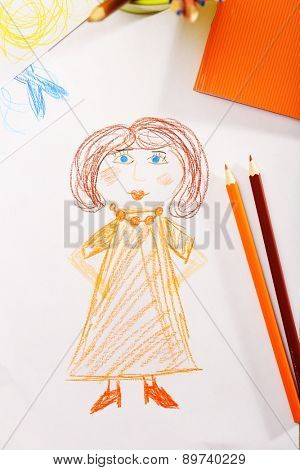 Kids drawing on white sheet of paper with crayons, closeup