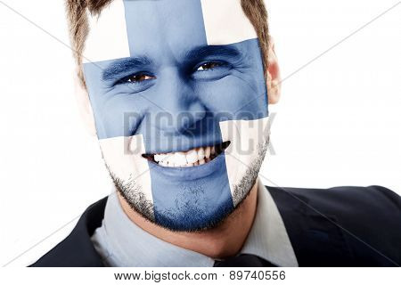 Happy man with Finland flag painted on face.