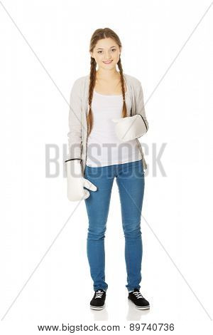 Teenage woman wearing boxing gloves.