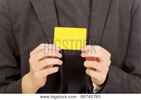 Business woman showing empty card.