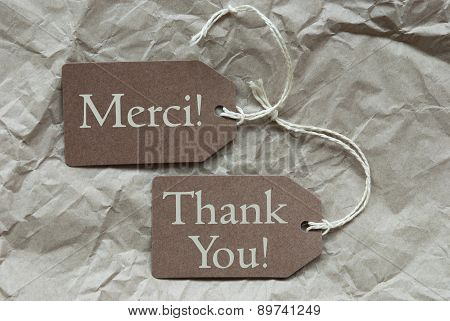 Two Beige Labels Merci Means Thank You