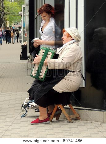Street Women Accordionist And Her Listener