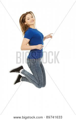 Beautiful cheerful jumping teen woman.