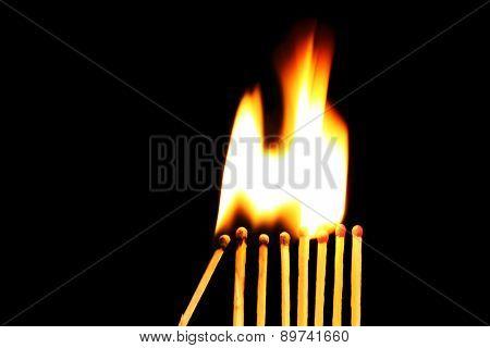 Burning matches on black background