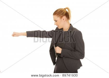 Frustrated and angry business woman boxing.
