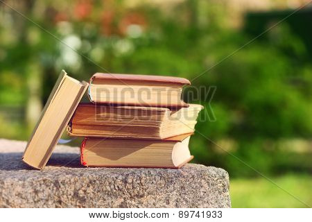 Stack of books outdoors, on blurred background