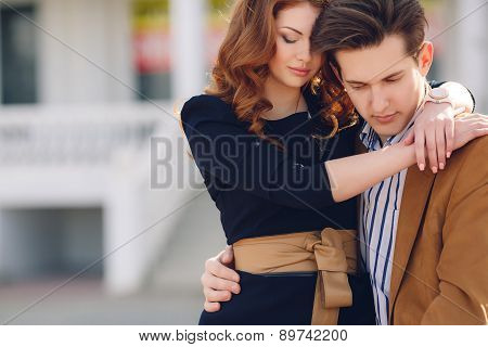 City Portrait of the young couple in love on a sunny day