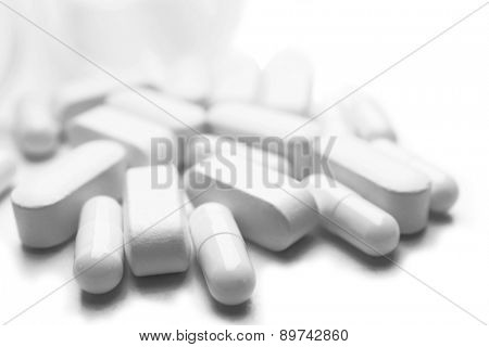 Pile of pills isolated on white