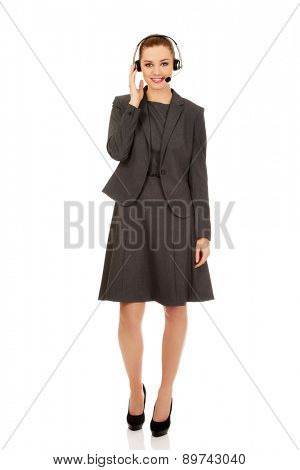 Beautiful young call-center woman in a suit.