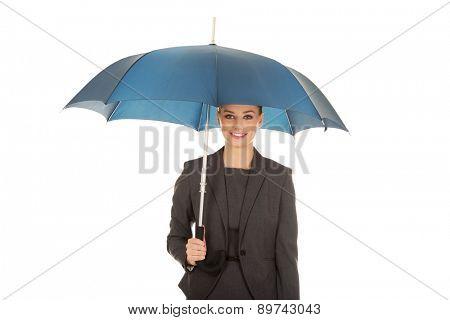 Blonde businesswoman holding an umbrella.