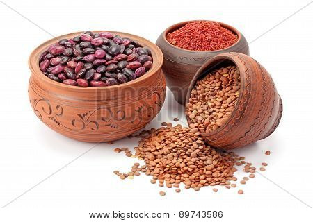 Red Rice And Lentils In Clay Pots