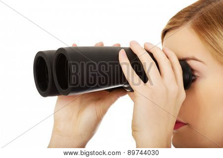 Beautiful woman looking into binoculars.