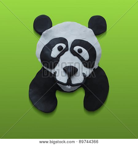 Cute Panda Head in Green Background.