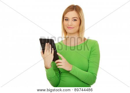 Beautiful caucasian woman with tablet.