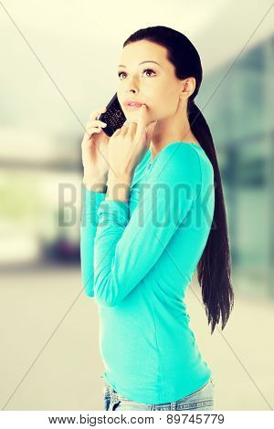 Young beautiful woman talking through phone