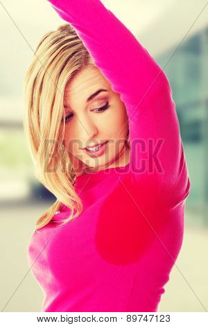 Young woman having sweating problem