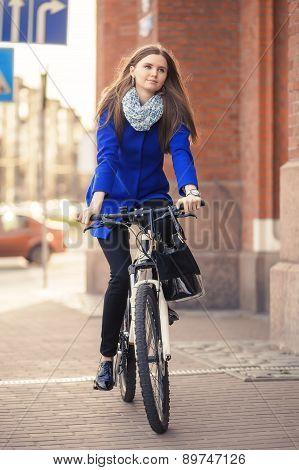Businesswoman Drives On Bike