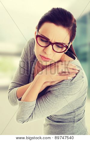 Beautiful woman with shoulder pain