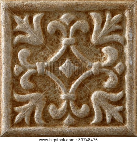 Travertine marble tile with floral decoration in the center