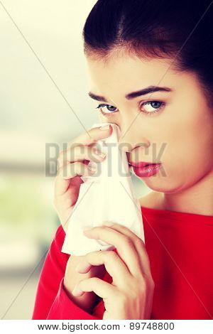 Unhappy young beautiful woman crying
