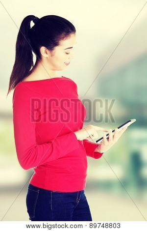 Beautiful happy young caucasian student woman using tablet computer